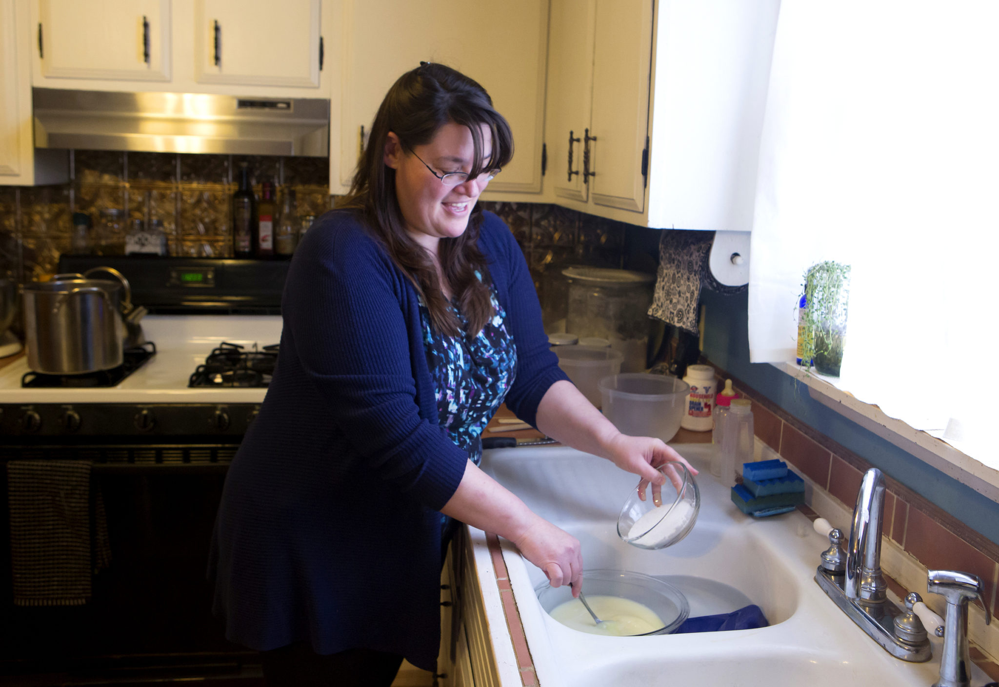 Sonja Twombly mixes lye with chilled goat milk to make soap atLally BrochFarmin Frankfort, Maine. | Ashley L. Conti