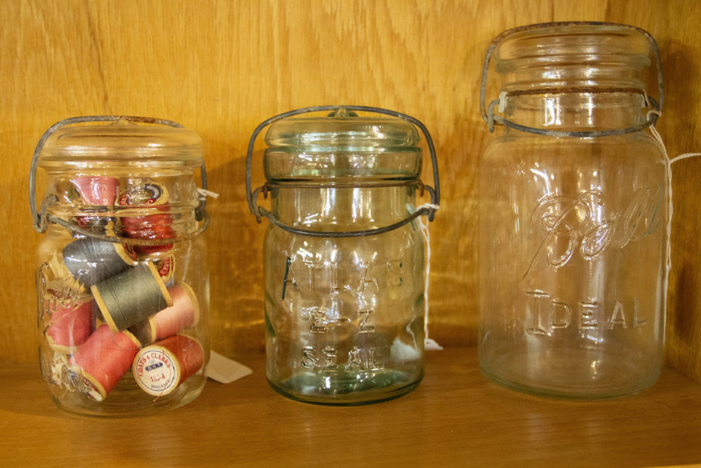 Old jars are a common type of vintage farmhouse decor and can be useful for sorting and storing small items.