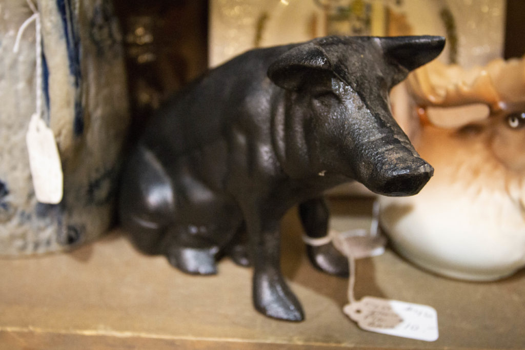 Old cast iron piggy banks and toys are nice small antiques to place in areas where you don't have much room. This particular piggy bank was found at Antique Marketplace & Cafe in Bangor, Maine, with a price tag of just $10.