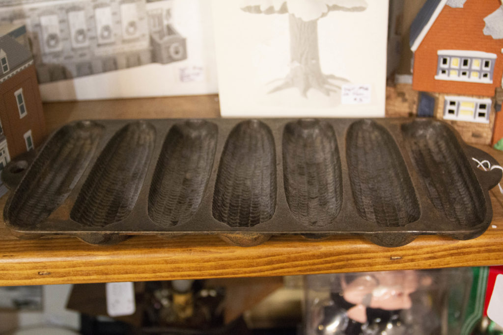 This corn bread pan could be displayed on a kitchen wall as vintage farmhouse style decor.