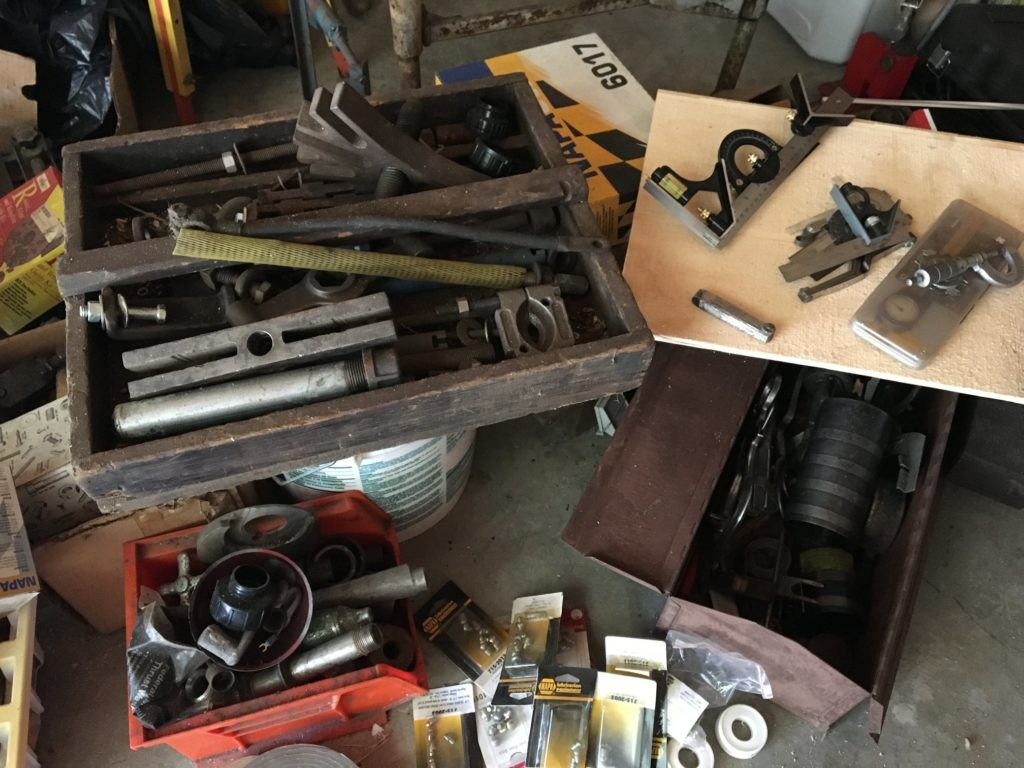 A wooden box and several tool chests full of old and vintage mechanics' tools.