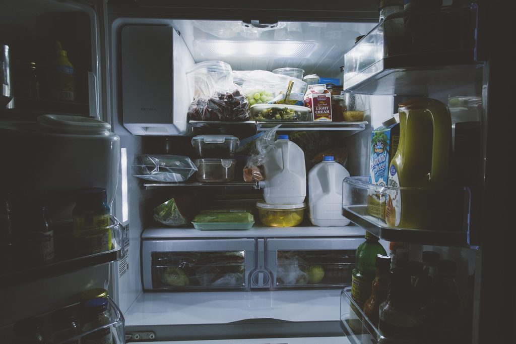 "Photo of the inside of an refrigerator that is crammed with food. Image by <a href=""https://pixabay.com/users/Pexels-2286921/?utm_source=link-attribution&utm_medium=referral&utm_campaign=image&utm_content=1868175"">Pexels</a> from <a href=""https://pixabay.com/?utm_source=link-attribution&utm_medium=referral&utm_campaign=image&utm_content=1868175"">Pixabay</a>"" class=""wp-image-2649830″/><figcaption>Image by <a href="